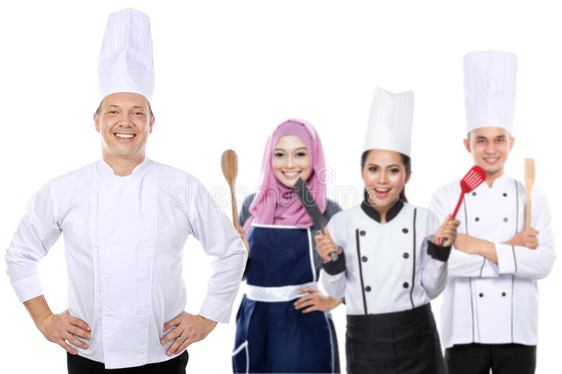 Group of happy chef. Portrait of group of happy chef isolated over white background stock photo