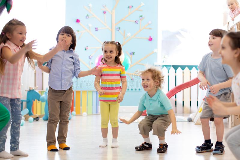 Group of happy children jump indoor. Kids play together royalty free stock images