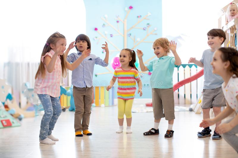 Group of happy children jump in club. Kids playing together stock images