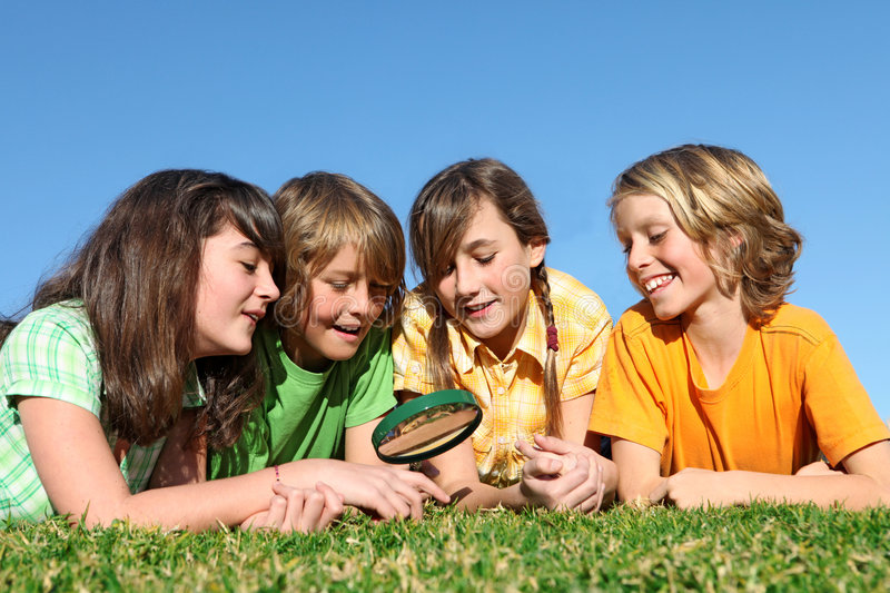 Group of happy children or kids playing stock photography