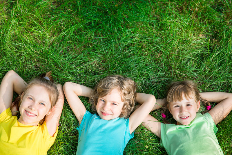 Group of happy children playing outdoors stock photos