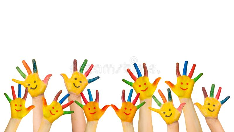 Group of happy children raises hands up. stock photos