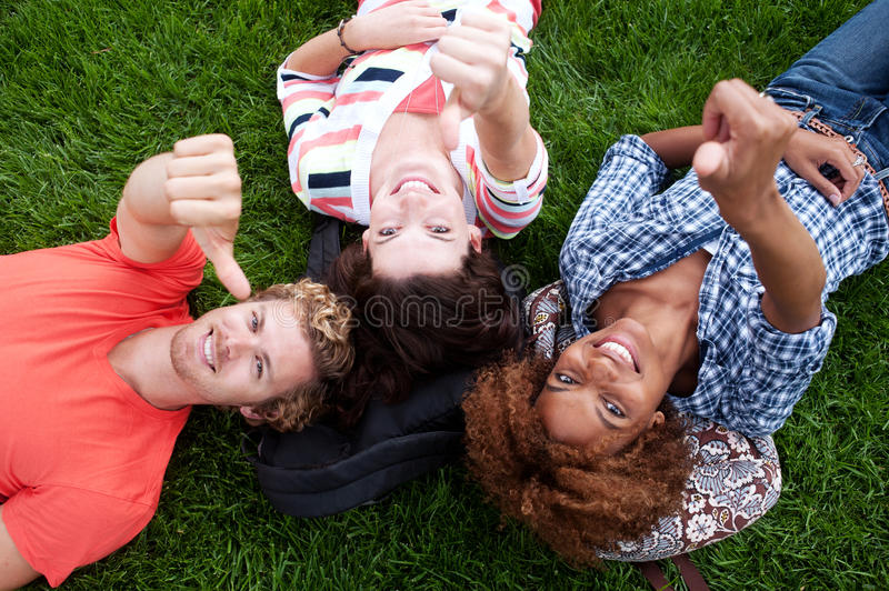Download Group Of Happy College Students In Grass Stock Photo - Image: 26785806