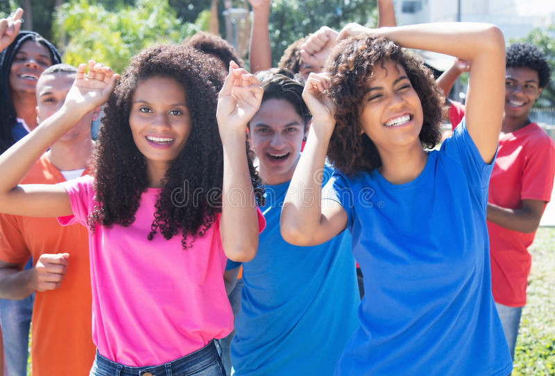 Group of happy dancing hispanic and latin and african american p. Eople outdoor in the city in the summer royalty free stock images