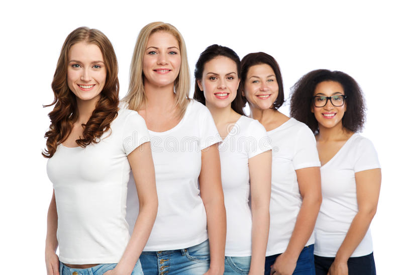 Group of happy different women in white t-shirts. Friendship, diverse, body positive and people concept - group of happy different size women in white t-shirts stock image