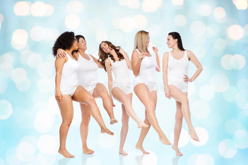 Group of happy different women in white underwear stock image