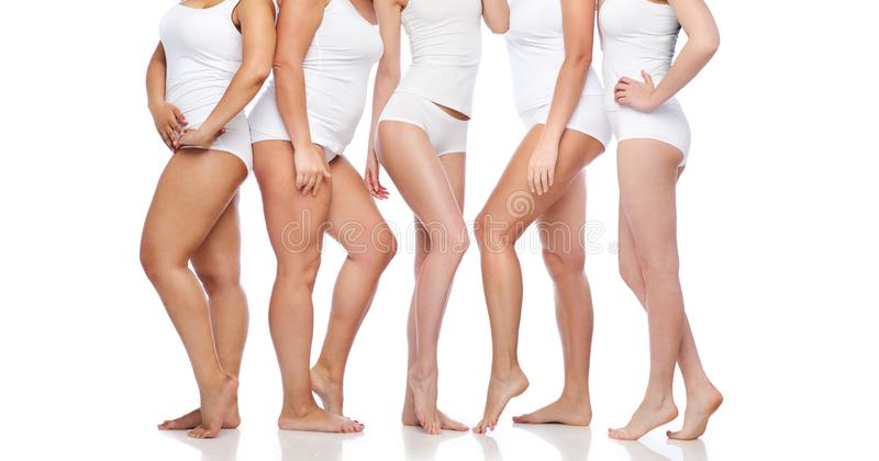 Group of happy diverse women in white underwear stock photography