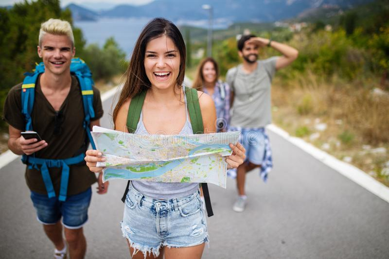Group of happy friend traveler walking and having fun. Travel lifestyle and vacation concept stock images
