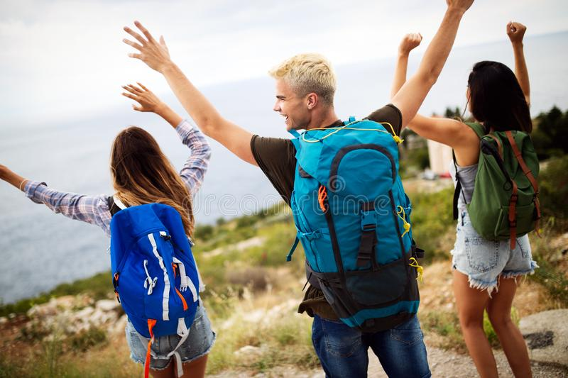 Group of happy friend traveler walking and having fun. Travel lifestyle and vacation concept stock photo