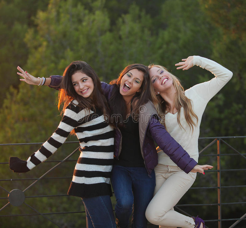 Group of happy friendly fashion teens. Outdoors royalty free stock photo