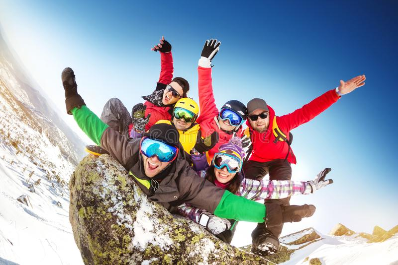 Group happy friends crazu fun ski resort. Group of happy friends skiers and snowboarders having crazy fun at ski resort royalty free stock images
