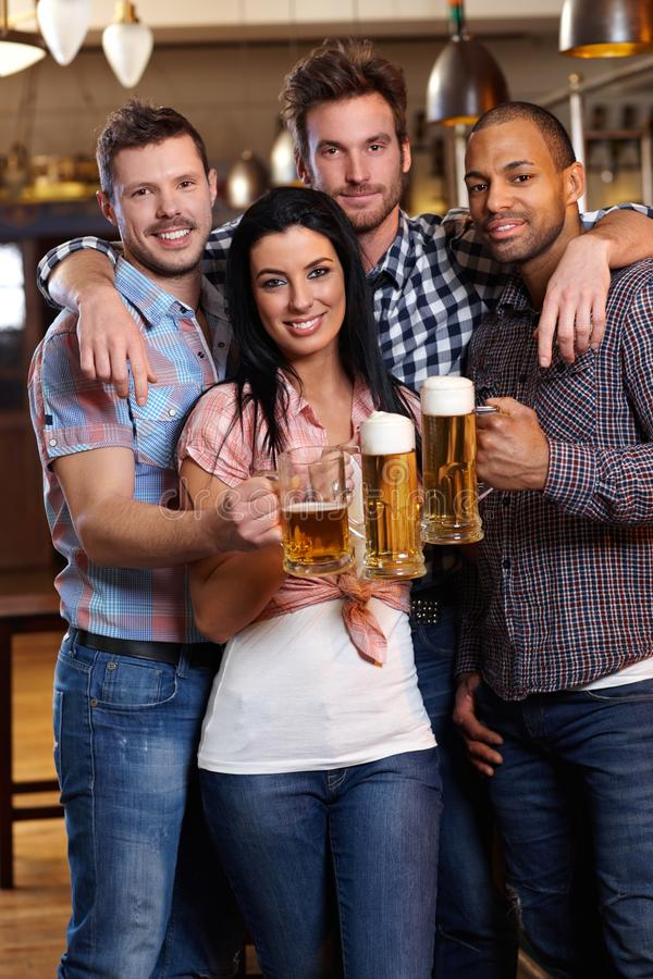 Download Group Of Happy Friends Drinking Beer At Pub Stock Photo - Image of ethnic, drinks: 26387164