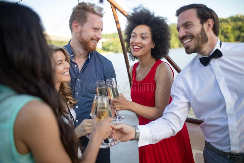 Group of happy friends drinking champagne and celebrating New Year stock image