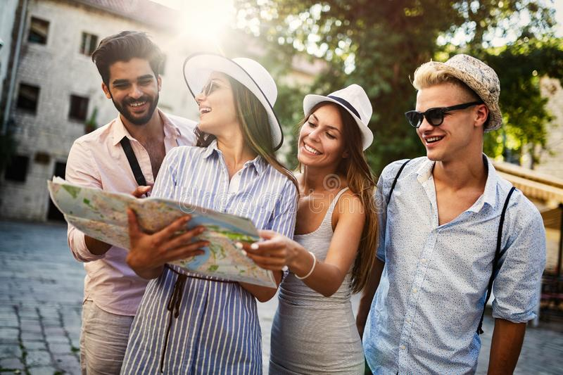 Group of happy friends enjoying sightseeing tour in the city. royalty free stock images