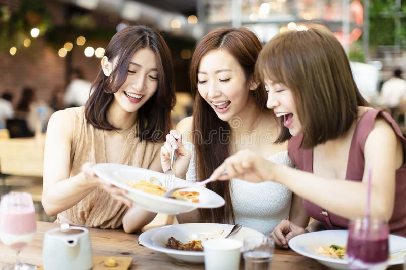Happy friends having dinner in the restaurant royalty free stock photo