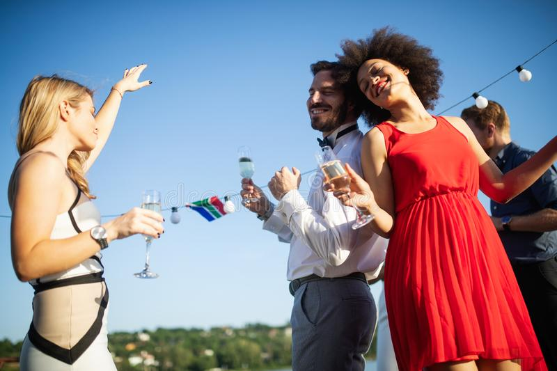 Group of friends having fun and celebrating group gathering stock image