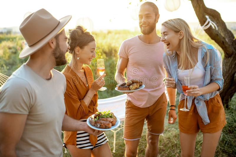 Friends having a picnic in the garden royalty free stock photo