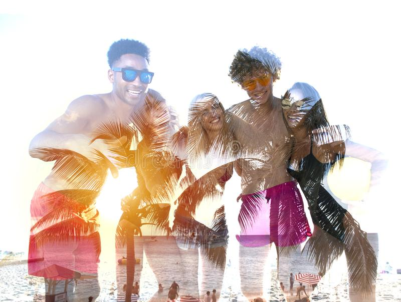 Group of happy friends having fun at ocean beach. double exposure royalty free stock photography