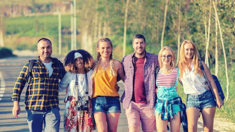 Group of happy friends having fun together outdoors stock image