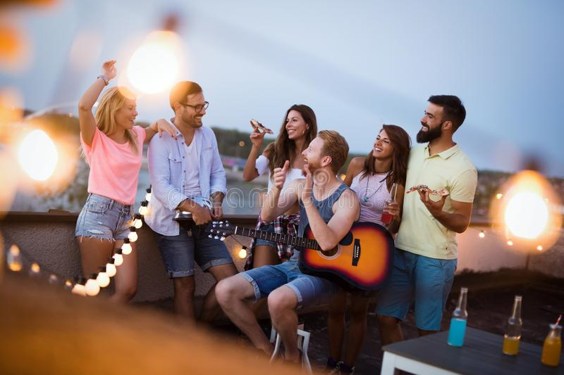 Group of happy friends having party on rooftop. Group of happy friends having party and fun on rooftop royalty free stock photos