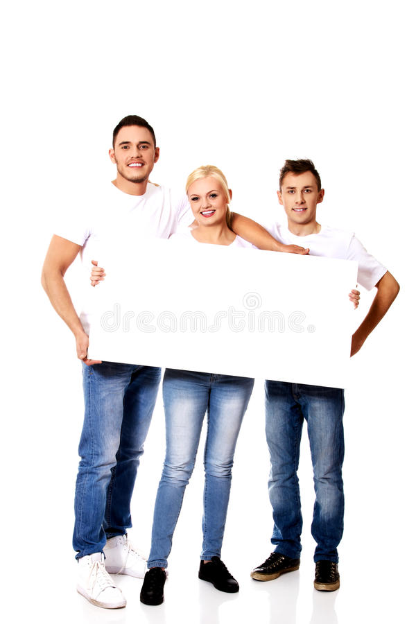 Group of happy friends holding empty banner stock image