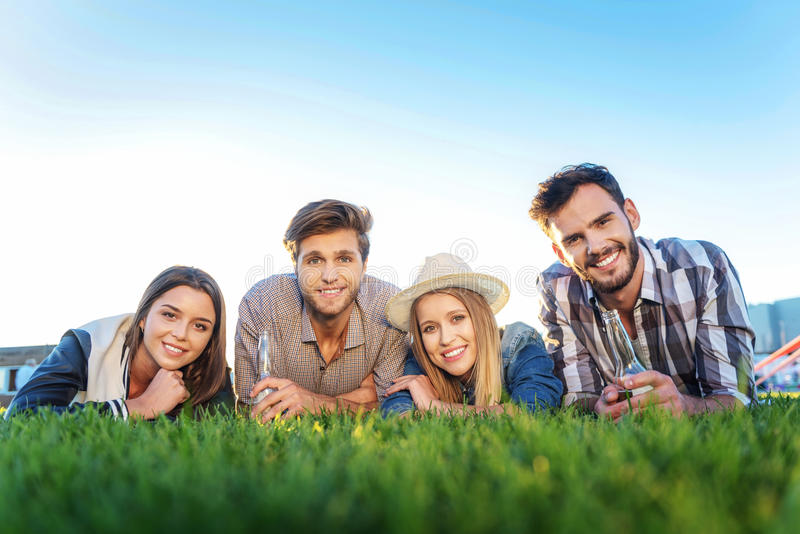 Group of happy friends on the lawn royalty free stock photo