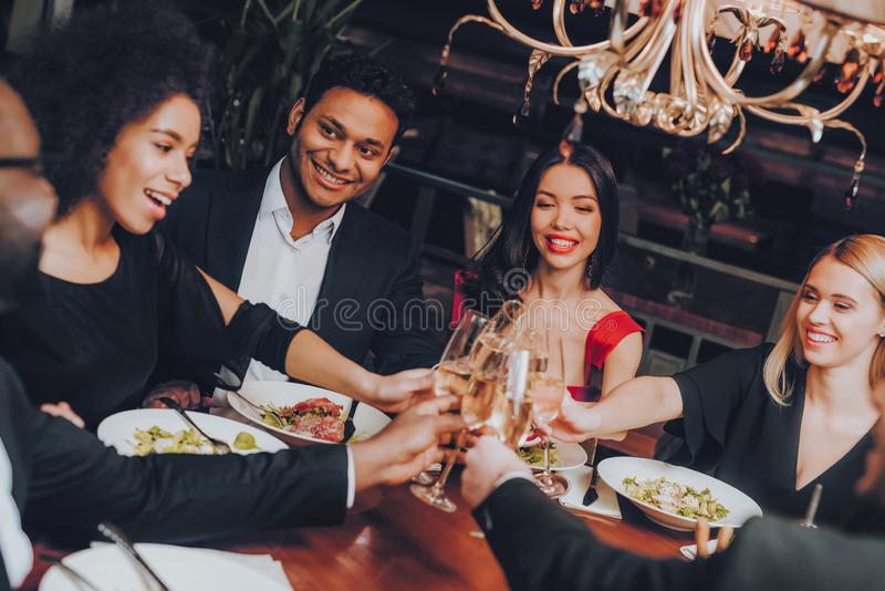 Group of Happy Friends Meeting and Having Dinner royalty free stock photos