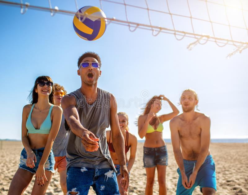 Group of friends playing at beach volley at the beach stock photos