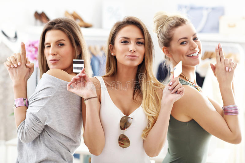 Group of happy friends shopping in store stock photos
