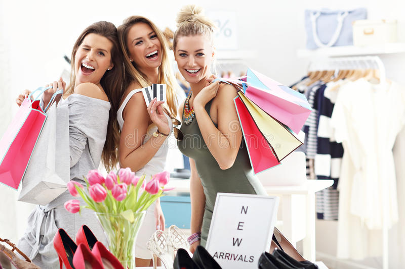 Group of happy friends shopping in store royalty free stock photo