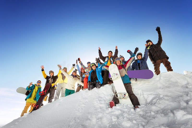 Group of happy friends skiers and snowboarders stock images