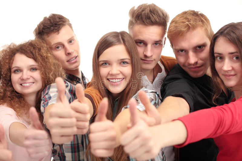 Group of happy friends standing with thumb up royalty free stock image