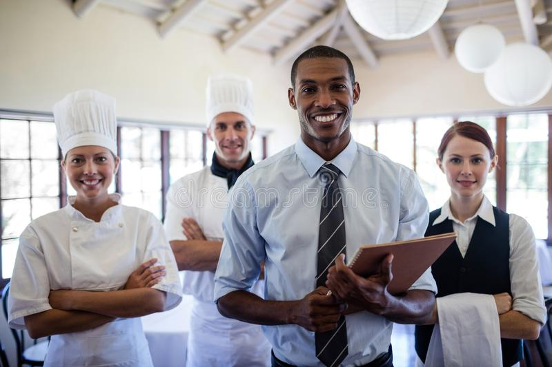 Group of hotel staffs standing in hotel royalty free stock photos