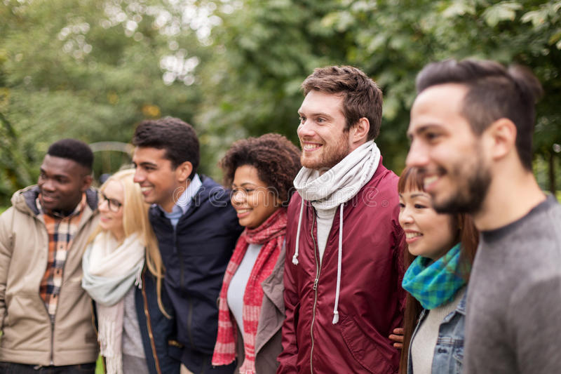 Group of happy international friends outdoors royalty free stock image