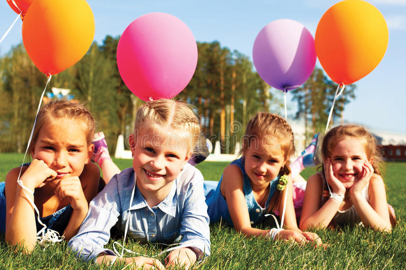 Group of happy kids with balloons royalty free stock photos