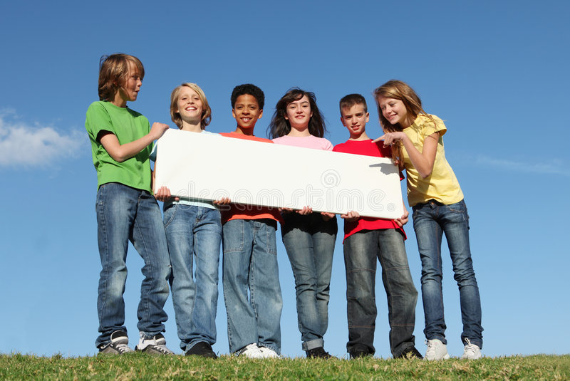 Group of happy kids,blank sign royalty free stock photography