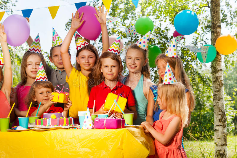 Group of happy kids celebrating birthday outdoor stock images
