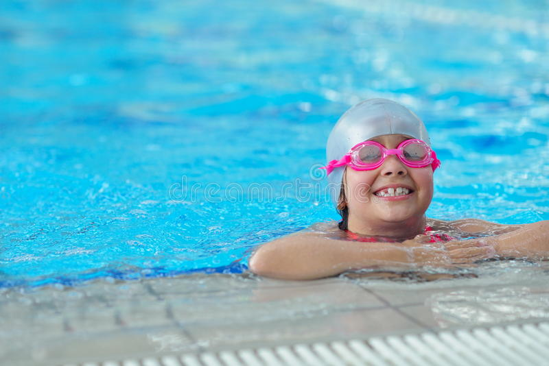 Group of happy kids children at swimming pool stock images