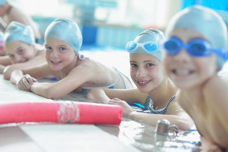 Group of happy kids children at swimming pool royalty free stock images