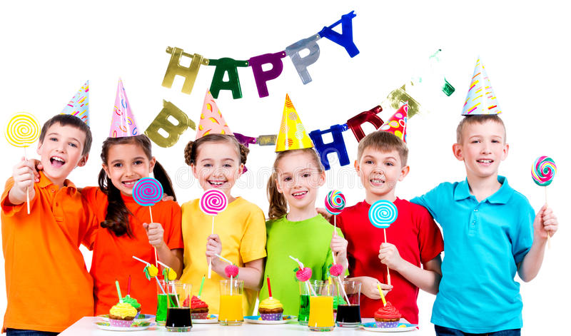 Group of happy kids with colorful candies. stock photography