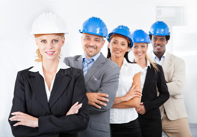 Group of happy multiracial architects stock photography