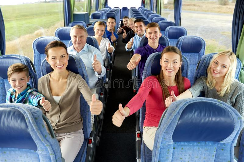 Group of happy passengers travelling by bus stock photo