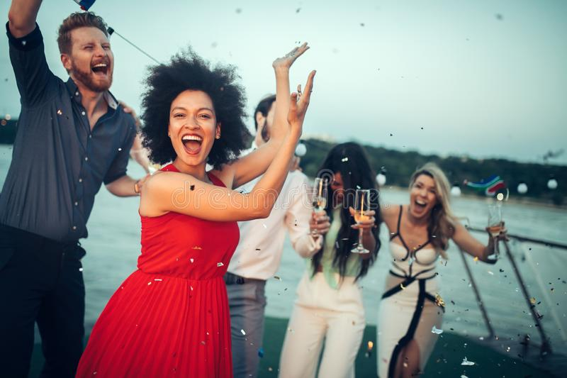 Group of happy people or friends having fun at party stock images