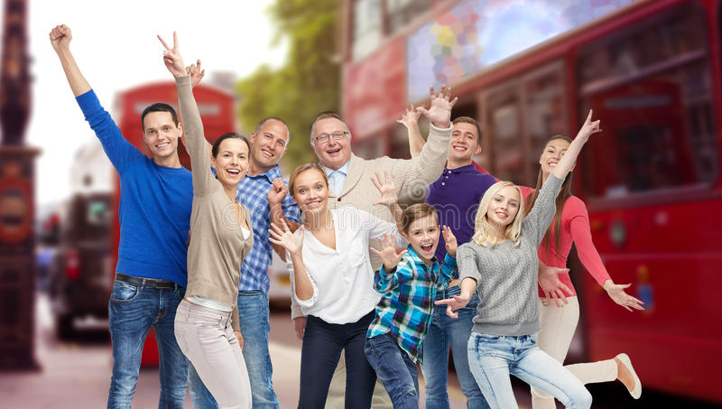 Group of happy people having fun over london city. Family, travel, tourism and people concept - group of happy men, women and boy having fun and waving hands stock photos