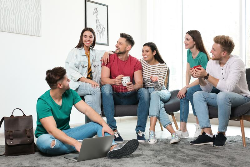 Group of happy people with laptop in room stock images