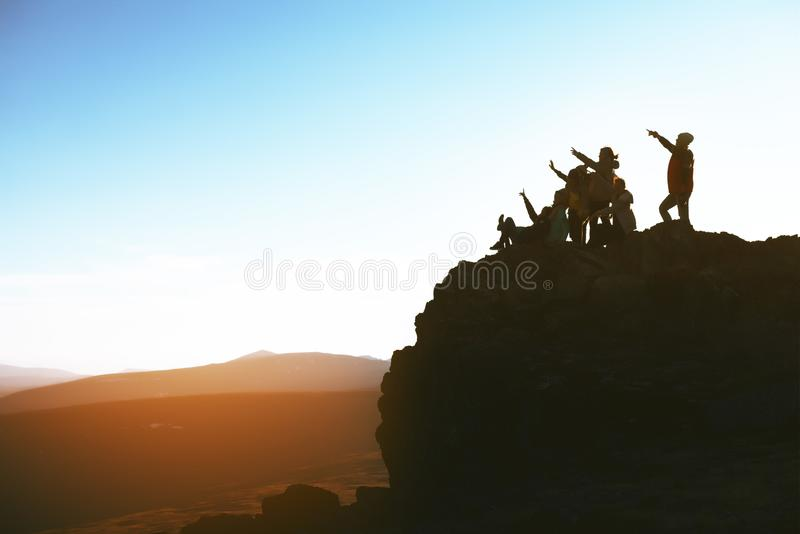 Group of happy people on mountain top stock photography