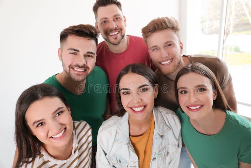 Group of happy people near window stock photo