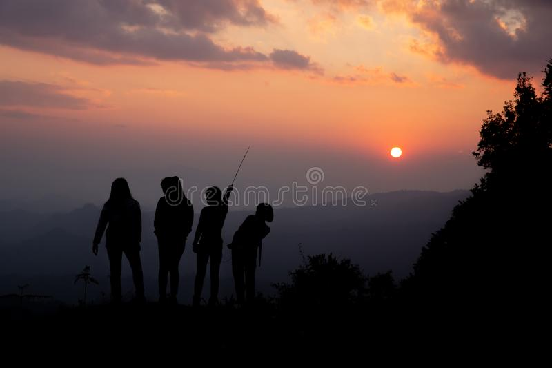 Group of happy people playing at summer sunset in nature royalty free stock images