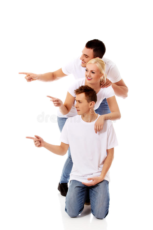 Group of happy people pointing for something royalty free stock image