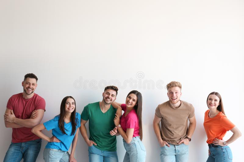 Group of happy people posing stock images